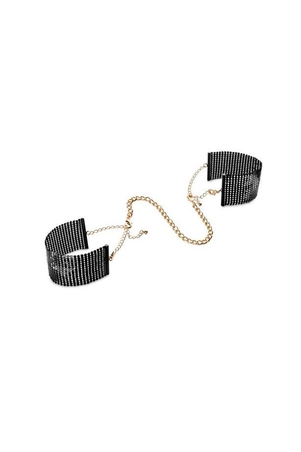 "Désir Métallique <a href=""http://shop.bijouxindiscrets.com/usa/en/accessories-of-passion/253-desir-metallique-metallic-mesh-handcuffs-8437008002569.html"">Black metallic mesh handcuffs</a>, $40."