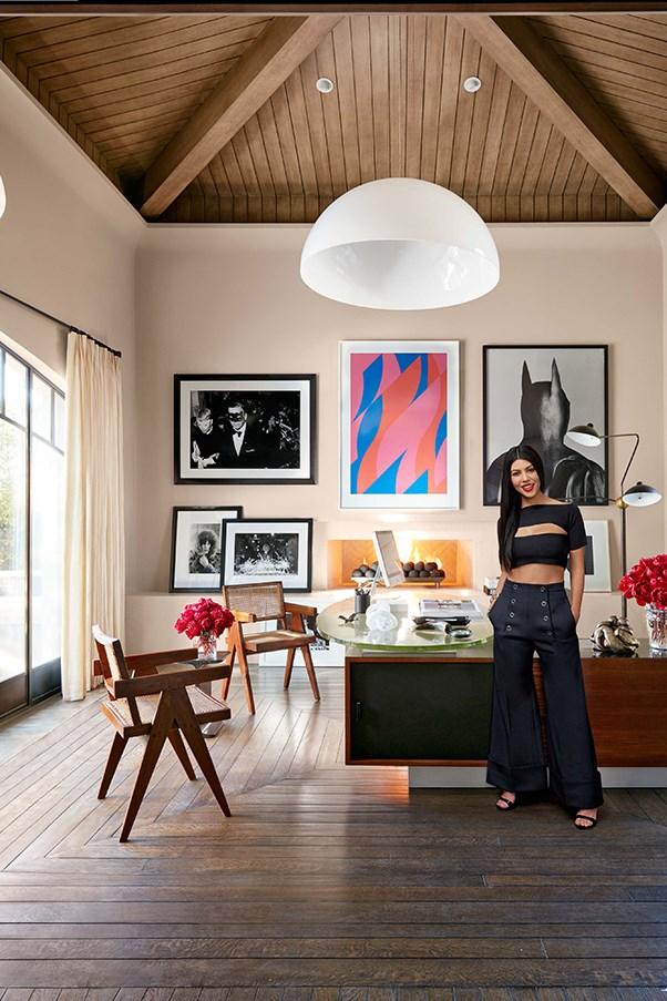 Kourtney Kardashian standing the office of her LA Calabasas home