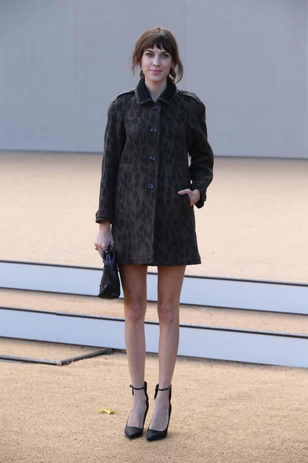 Alexa Chung flaunts her pins in a leopard print Louis Vuitton coat.