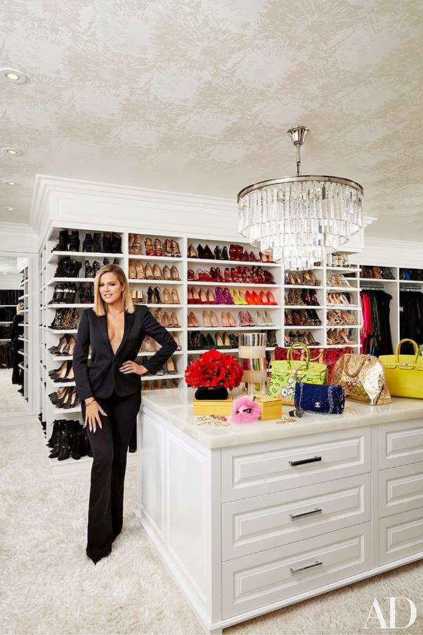 Khloe Kardashian in her closet for Architectural Digest