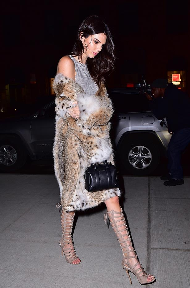 While attending the launch of her fashion line with sister Kylie, Kendall rocked a 'Kendall + Kylie' look consisting of a grey shirt dress, faux fur coat and knee-high sandals.