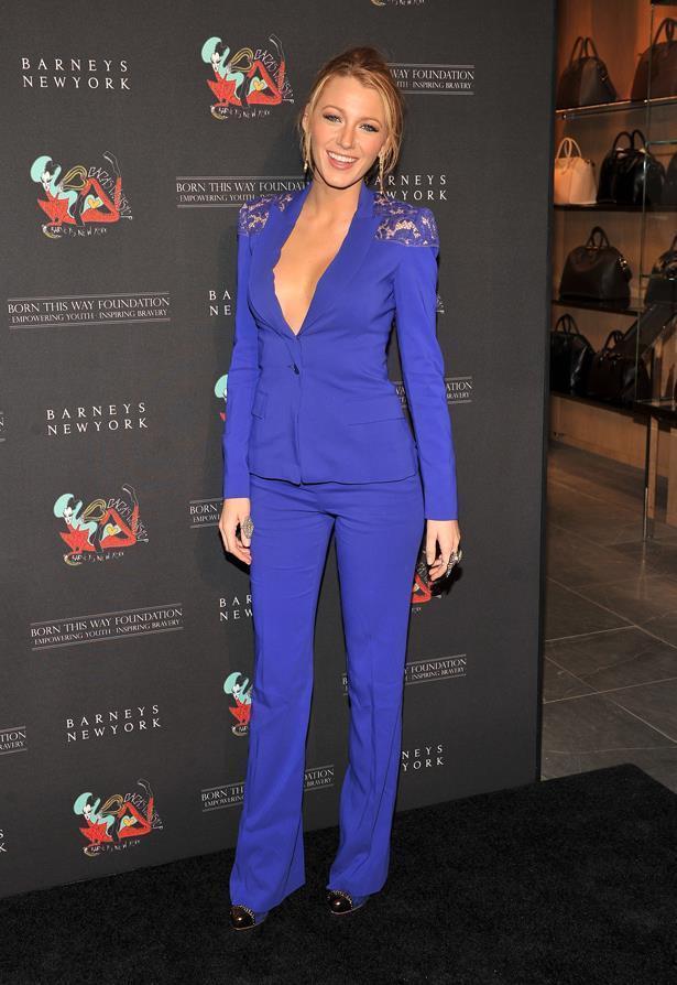 A blue powersuit with lace shoulder inserts.