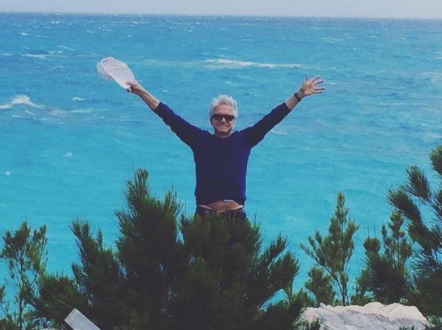 "Catherine Zeta-Jones posted this cute snap of her husband Michael Douglas on holiday, ""Happy to see me or the Bermudian bay?!!!! Don't know!!!! But love him all the same. Happy Valentine's Day Michael!!!!"""