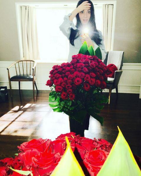 Olivia Munn looks very overwhelmed with her roses from boyfriend Aaron Rodgers.