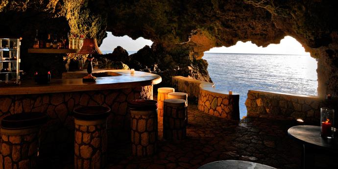 The Caves, Jamaica: A boutique, cliff-side hotel with private cave dining and a bar with a difference. It's located a few minutes down the road from the white sands of Coral Beach, but why bother when you can jump straight off the low-walled edge of the hotel into the water below?