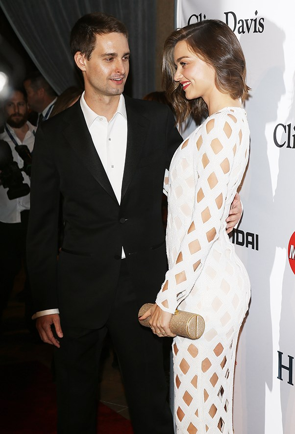 Miranda Kerr and Evan Spiegel on the pre-GRAMMYs red carpet.