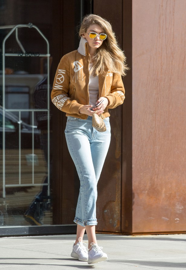 Gigi paired her blue jeans with an aviator bomber jacket.