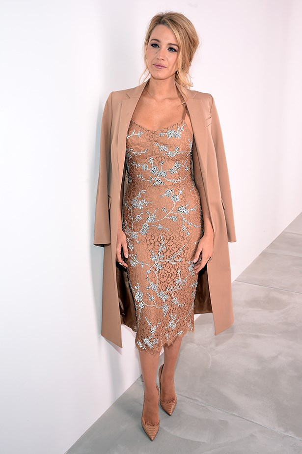 Attending the Michael Kors show in New York, Blake paired an embellished slip dress with a nude overcoat and pointed heels.