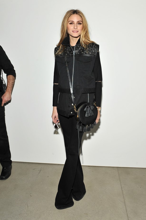 Flared pants, a studded leather vest and a round cross body? Yes please.