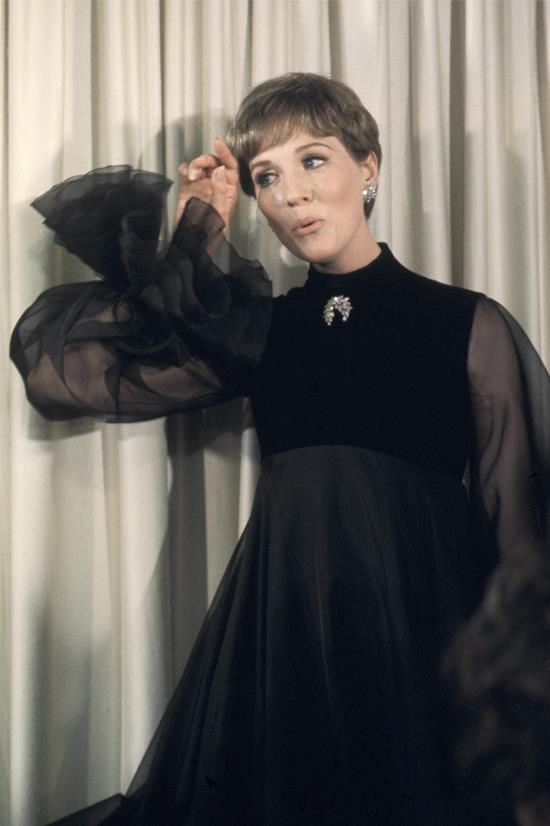 <strong>Julie Andrews</strong>, 1968 <br><br> <strong>Designer:</strong> Unknown <br> <strong>Why we love it:</strong> Because it's Julie Andrews! And because this Victorian style gown is a little different.