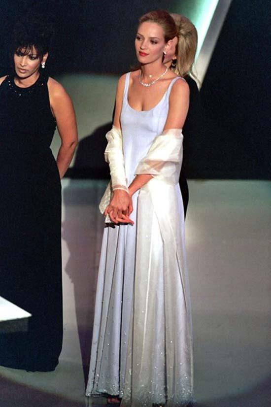 <strong>Uma Thurman</strong>, 1995 <br><br> <strong>Designer:</strong> Prada <br> <strong>Why we love it:</strong> Another understated gown, but paired with the perfect jewels and a classic up-do.