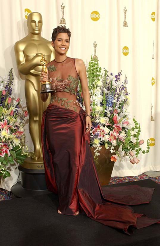 <strong>Halle Berry</strong>, 2001 <br><br> <strong>Designer:</strong> Elie Saab <br> <strong>Why we love it:</strong> Hale Berry is a goddess in this Elie Saab gown. The red and green colours suit her skin tone and make the look super fresh. And it happens to go rather nicely with the Oscar she picked up that year.