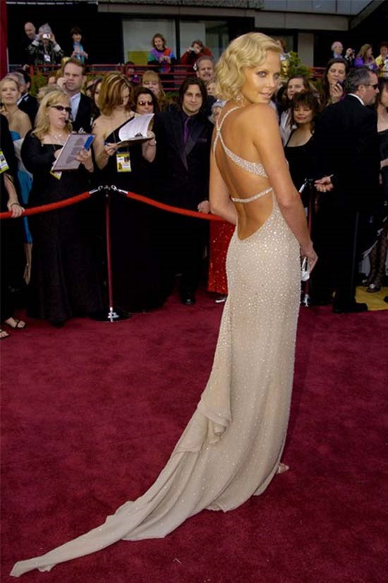 <strong>Charlize Theron</strong>, 2004 <br><br> <strong>Designer:</strong> Gucci <br> <strong>Why we love it:</strong> The gorgeous Charlize Theron is the epitome of glamour in this beaded Gucci gown. The exposed back adds a touch of sexy.