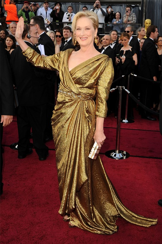 <strong>Meryl Streep</strong>, 2012 <br><br> <strong>Designer:</strong> Lanvin <br> <strong>Why we love it:</strong> Because it's Meryl Streep! And if anyone deserves to look like a real-life Oscar, it's her. She looks absolutely radiating in this shiny gown.