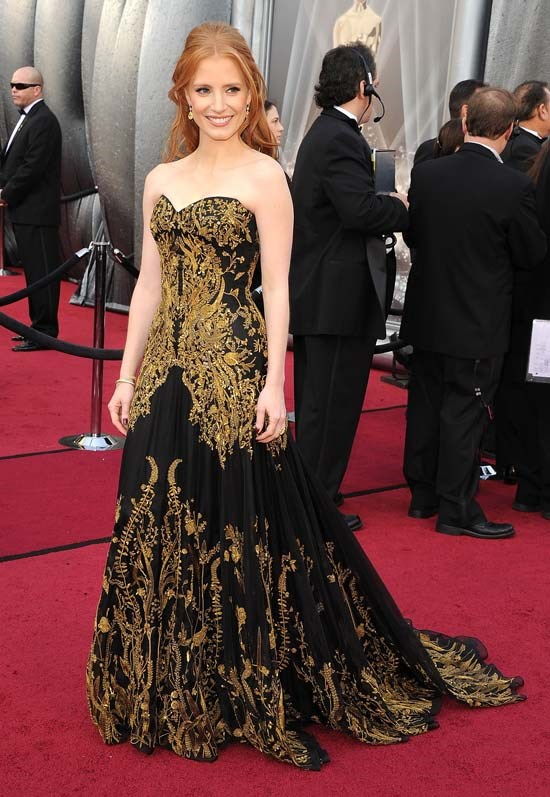 <strong>Jessica Chastain</strong>, 2012 <br><br> <strong>Designer:</strong> Alexander McQueen <br> <strong>Why we love it:</strong> 2012 was a big year for the cast from <em>The Help</em>. Jessica's fiery red locks were the perfect complement to the gold embellishments on her dress.