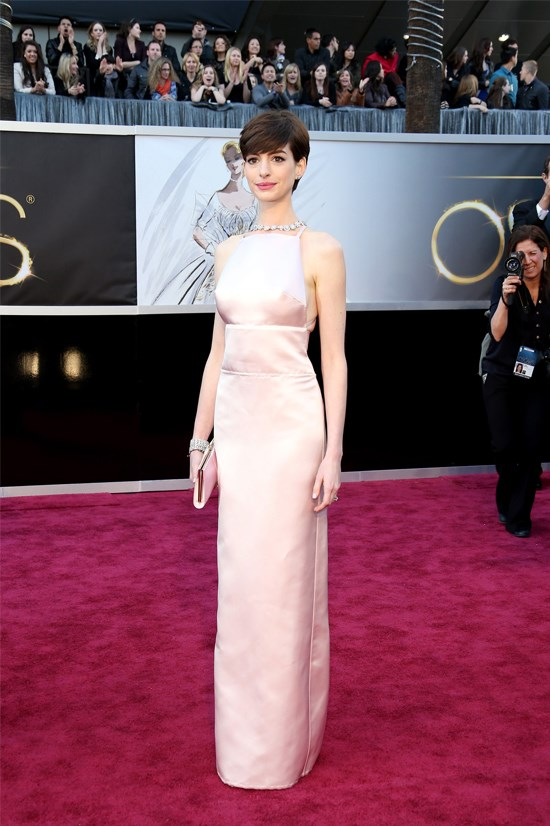 <strong>Anne Hathaway</strong>, 2013 <br><br> <strong>Designer:</strong> Prada <br> <strong>Why we love it:</strong> This super soft shade of pink and simple style suits Anne to a tee. The Tiffany & Co necklace compliments the gown perfectly.