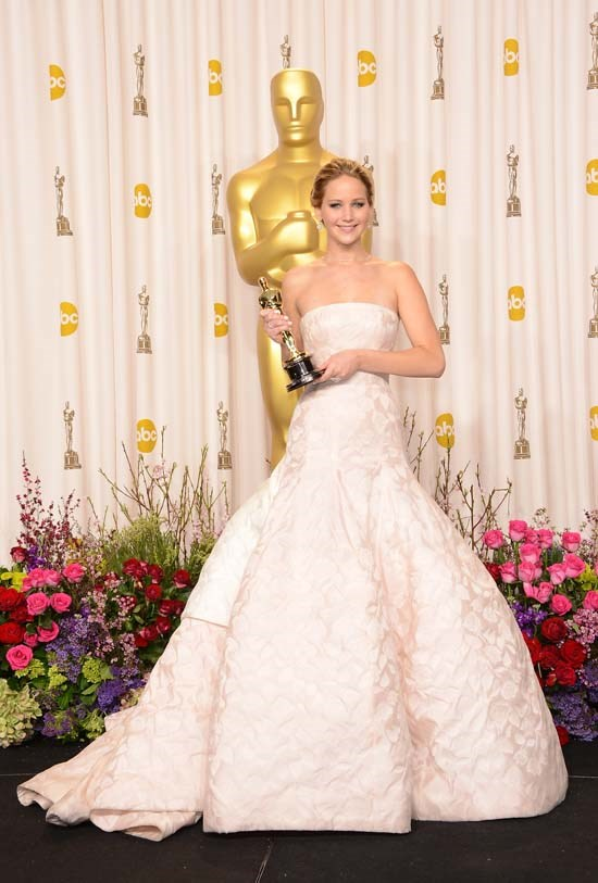<strong>Jennifer Lawrence</strong>, 2013 <br><br> <strong>Designer:</strong> Dior Haute Couture, of course! <br> <strong>Why we love it:</strong> J-Law was the epitome of elegance at the 2013 Academy Awards. This strapless Dior gown was THE perfect Oscars dress and probably one of the top favourites of all time.