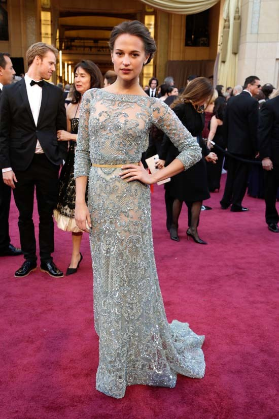 <strong>Alicia Vikander</strong>, 2013 <br><br> <strong>Designer:</strong> Elie Saab Couture <br> <strong>Why we love it:</strong> Alicia looks like a heavenly vision in this jewelled Elie Saab gown. The whole look oozes femininity.