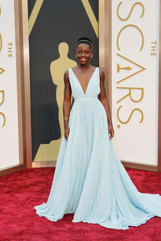 <strong>Lupita Nyong'o</strong>, 2014 <br><br> <strong>Designer:</strong> Prada <br> <strong>Why we love it:</strong> Definitely one of the most talked about Oscars dress (for obvious reasons). Lupita wore this baby blue flowing gown with graceful poise, it was hard to look away.