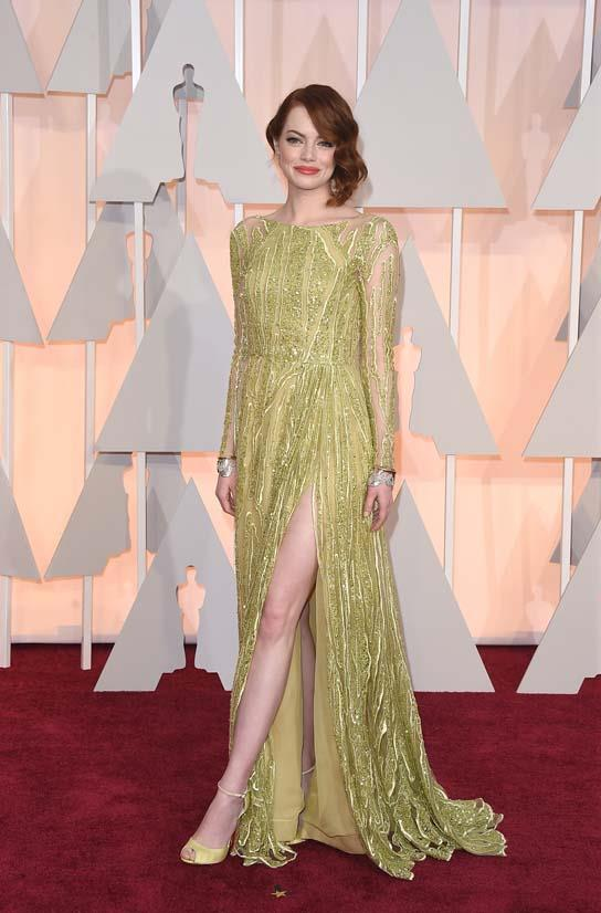 <strong>Emma Stone</strong>, 2015 <br><br> <strong>Designer:</strong> Elie Saab Couture <br> <strong>Why we love it:</strong> This colour was a super fresh standout on the red carpet. Emma finished the look with matching shoes and a lovely peachy pink lip.