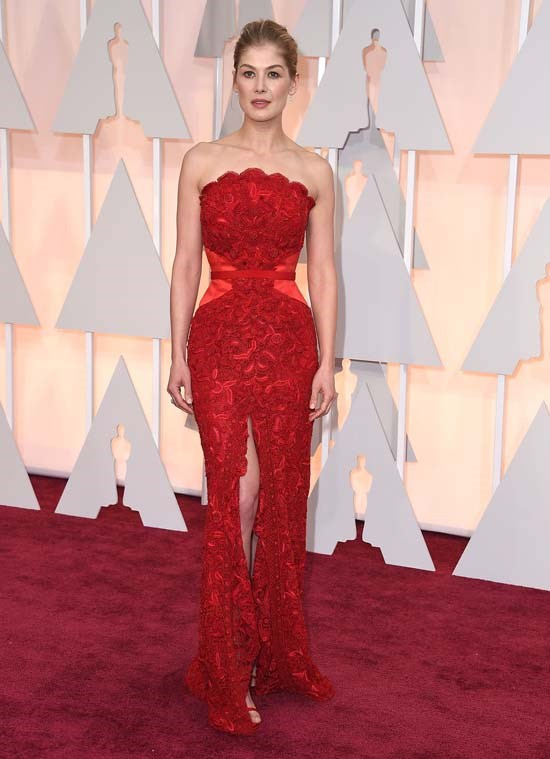 <strong>Rosamund Pike</strong>, 2015 <br><br> <strong>Designer:</strong> Givenchy Couture <br> <strong>Why we love it:</strong> Rosamund Pike was a standout at the 2015 Academy Awards in this vivacious red gown. She completed the look elegantly with a classic up-do and diamond earrings.