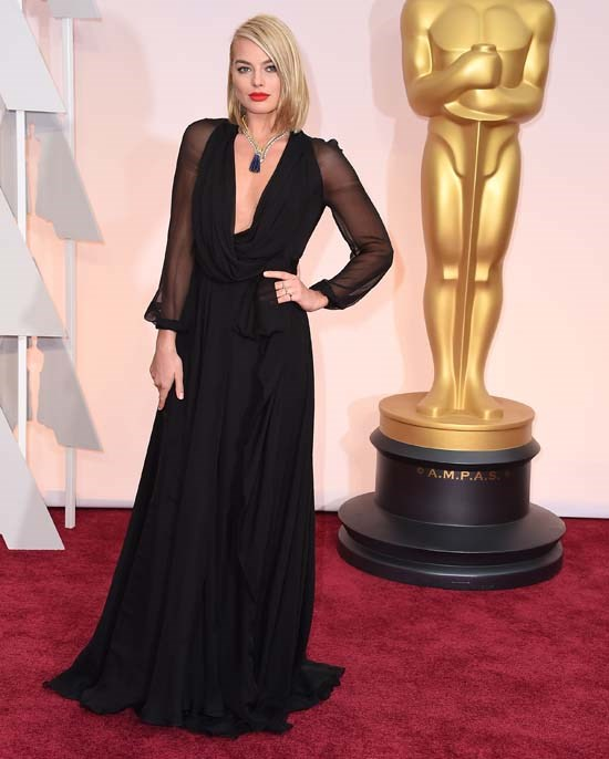 <strong>Margot Robbie</strong>, 2015 <br><br> <strong>Designer:</strong> Saint Laurent <br> <strong>Why we love it:</strong> 2015 was a big year in Oscars fashion. Our very own Margot Robbie nailed it last year with this simple, flowing Saint Laurent dress, paired with the perfect Van Cleef & Arpels necklace and a sexy bob.