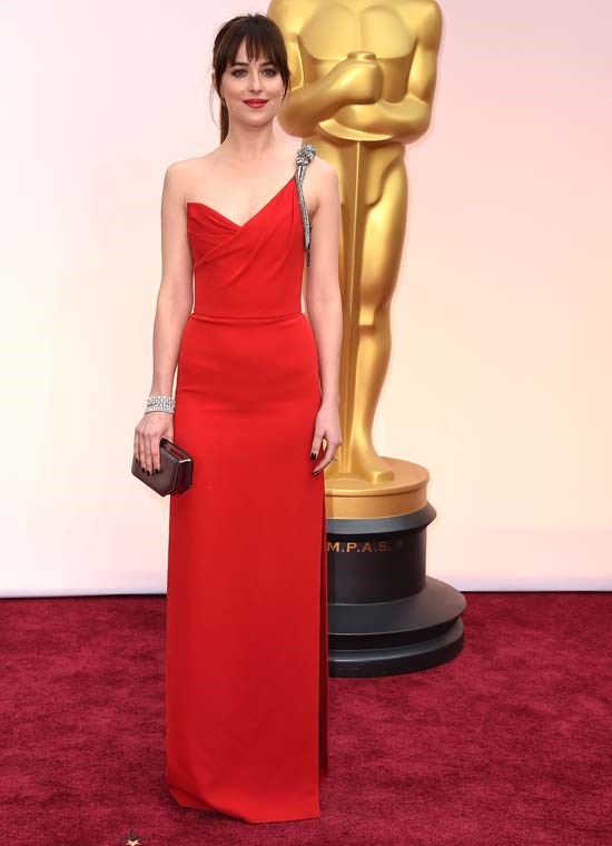 <strong>Dakota Johnson</strong>, 2015 <br><br> <strong>Designer:</strong> Saint Laurent <br> <strong>Why we love it:</strong> Another stunning red number from 2015, Dakota Johnson secures herself in Hollywood's fashion scene with this Saint Laurent gown. The touch of silver detailing in the strap is an understated touch.