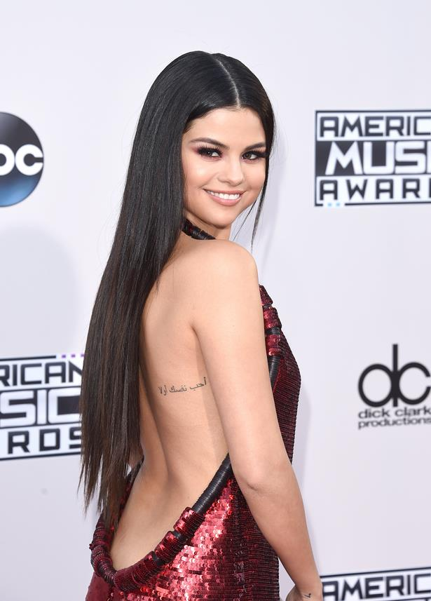 Selena Gomez has this piece of Arabic text which reads 'Love Yourself First'.