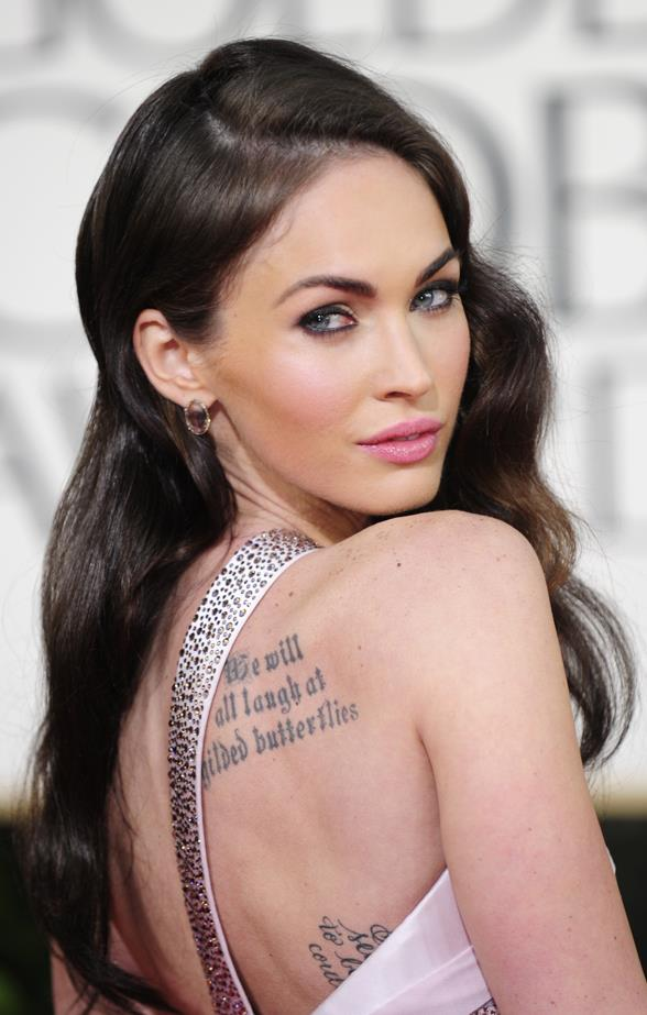 In addition to his Shakespeare quote, Megan also has Marilyn Monroe's face on her arm and a quote on her side.