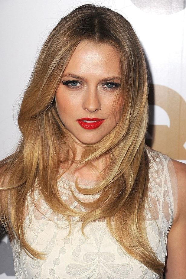 2012, Palmer is the picture of classic beauty with a red lip and full, flirty lashes at the GQ Men of the Year Party.