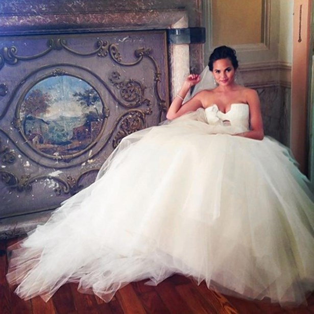 Chrissy Teigen wore two white dresses for her 2013 wedding to John Legend.