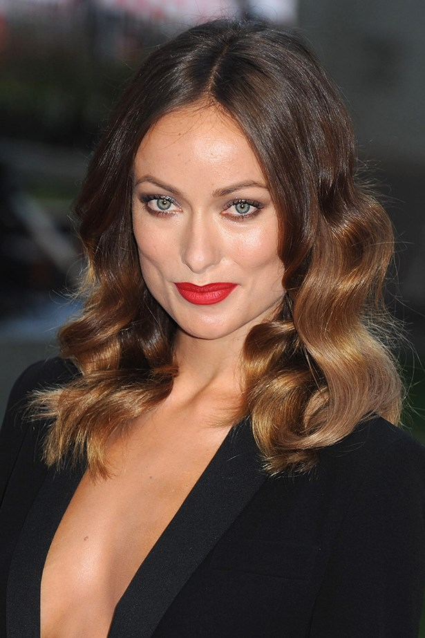 2013, Olivia does classic Hollywood glamour with a bright red lip and big waves at the World Premiere of <em>Rush </em>in London.