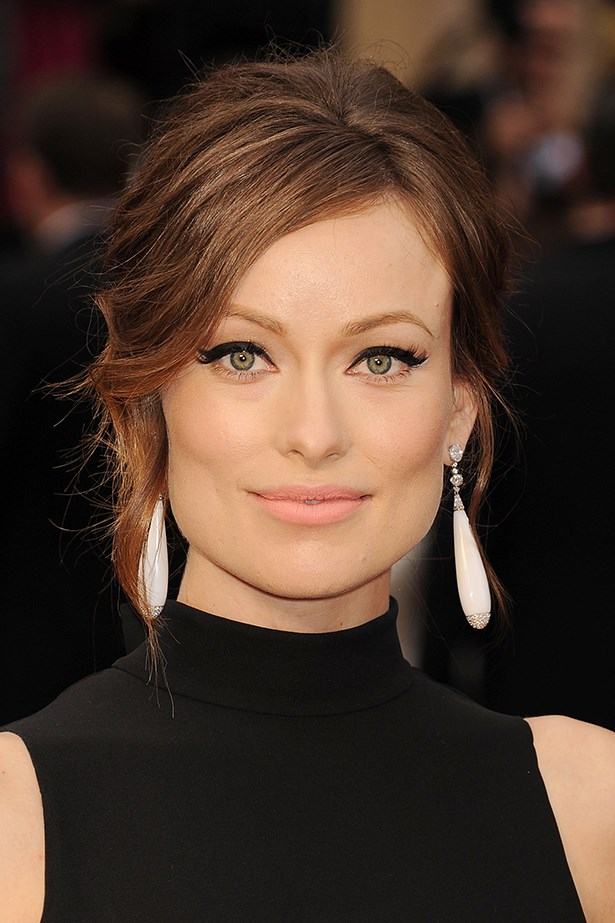 2014, thick flicks of eyeliner and a backcombed up-do at the 86th Annual Academy Awards giving 60's glamour flashbacks.