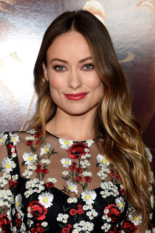 2016, Olivia dons a rose-red pout and soft waves at the New York screening of <em>Race</em>.
