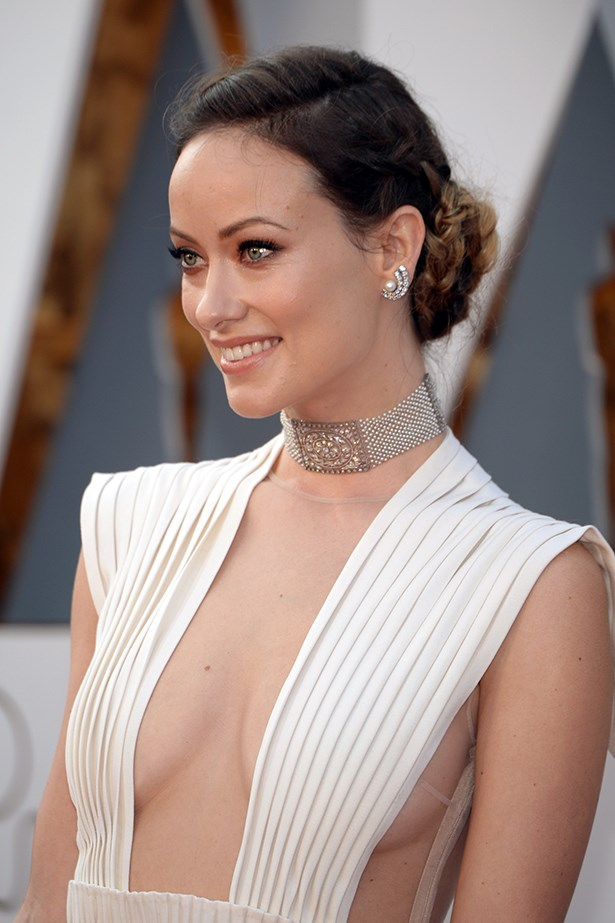 2016, Wilde shines on the red carpet of the 86th Annual Academy Awards with a shimmering bronze eye and braided bun.