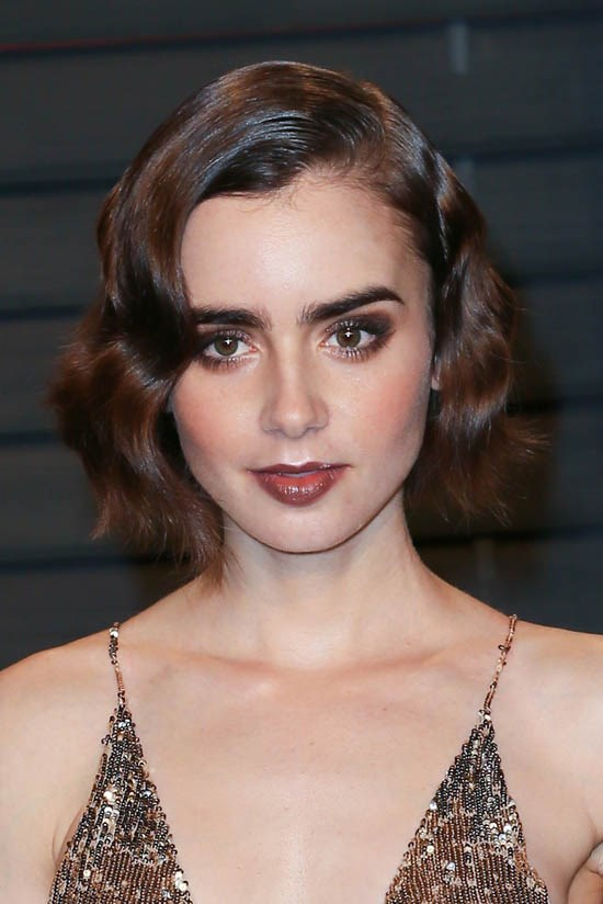 <strong>Lily Collins</strong> <br><br> Lily Collins has been sporting short hair for a while now. She channeled old Hollywood glamour with this look at the Vanity Fair Oscar's after party this year.
