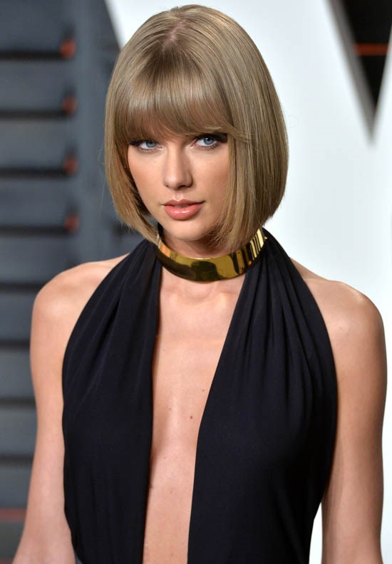 <strong>Taylor Swift</strong> <br><br> Taylor Swift has been pretty creative with her bob lately, styling it straight here at the Vanity Fair Oscar's after party this year.