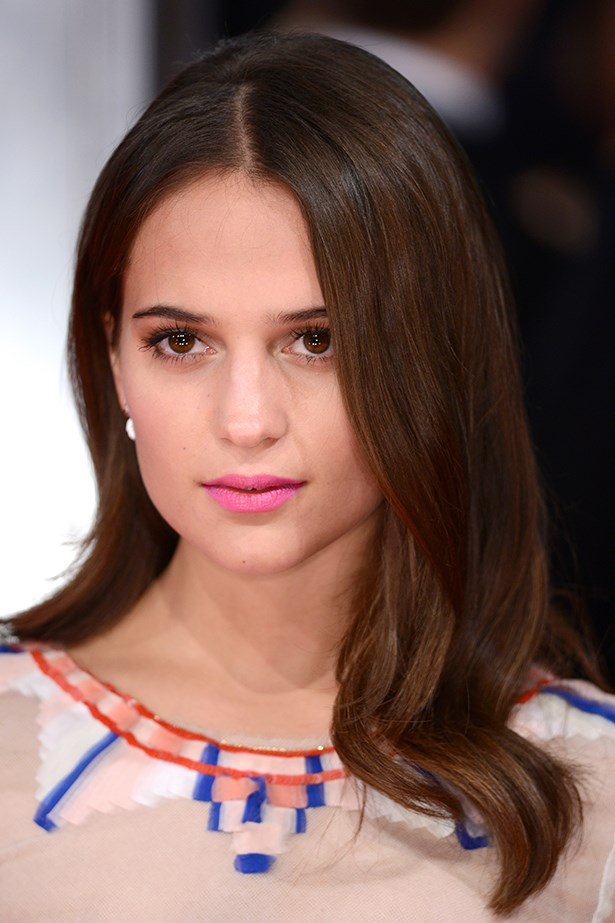 2014, Alicia dons sleek waves and a pop of pink lipstick at the <strong>EE British Academy Film Awards</strong>.