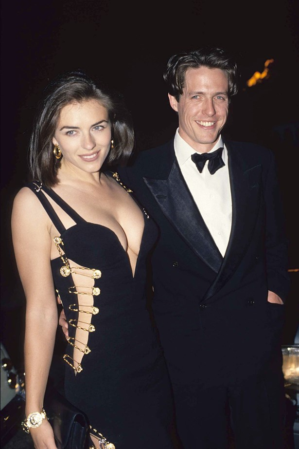 HUGH GRANT AND ELIZABETH HURLEY<P> <P> We threw this picture of Hugh and Liz into this gallery for the safety pin dress alone. As for the 90s couple realness? Just an added extra.
