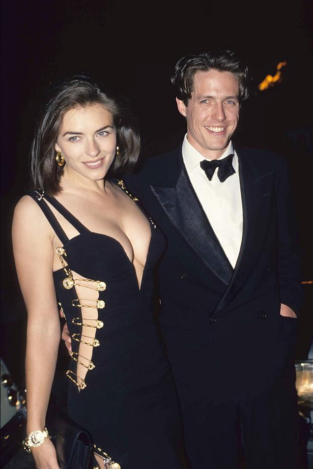 **Hugh Grant and Elizabeth Hurley** <br><br> We threw this picture of Hugh and Liz into this gallery for the safety pin dress alone. As for the '90s couple realness? Just an added extra.