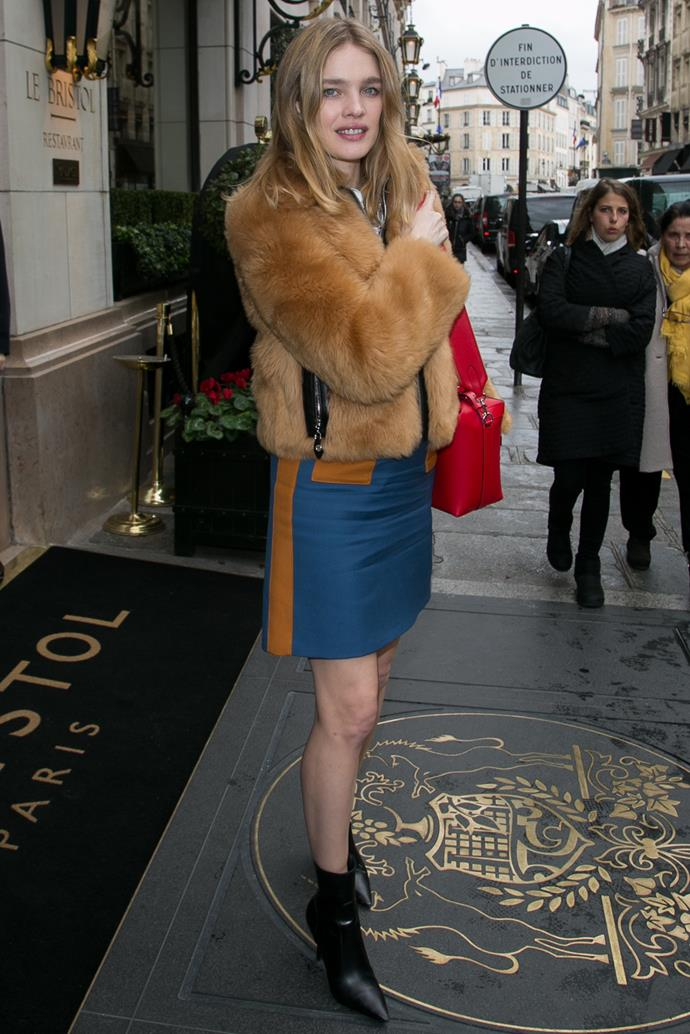**Natalia Vodianova** in a cropped faux fur jacket.