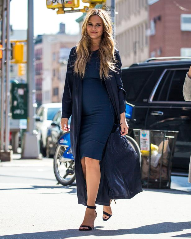 **First pregnancy:** <br><br>Chrissy has a thing for the 'tight dress with flowy coat' thing - and we love it, 2016.