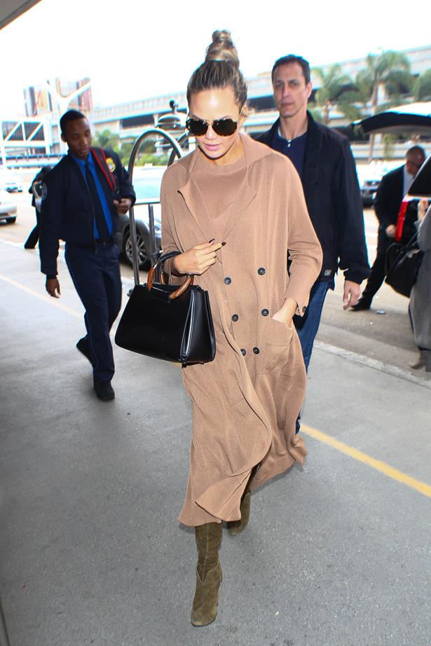 **First pregnancy:** <br><br>All nude with olive boots at LAX, 2016.
