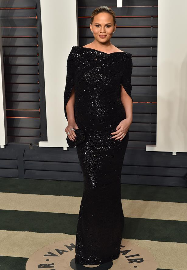 **First pregnancy:** <br><br>Chrissy rocked a black sequin gown by Talbot Runhof for the *Vanity Fair* Oscars after party, 2016.
