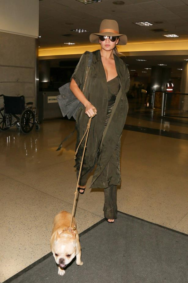 **First pregnancy:** <br><br>At LAX in head-to-toe olive, 2015.