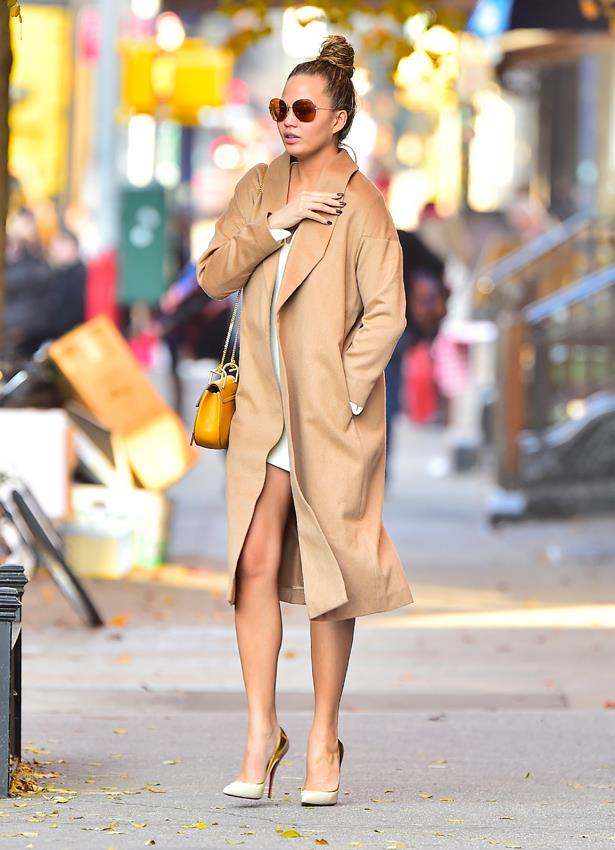 **First pregnancy:** <br><br>Wearing a Chloe bag, a white dress and camel coat while out in New York city, 2015.