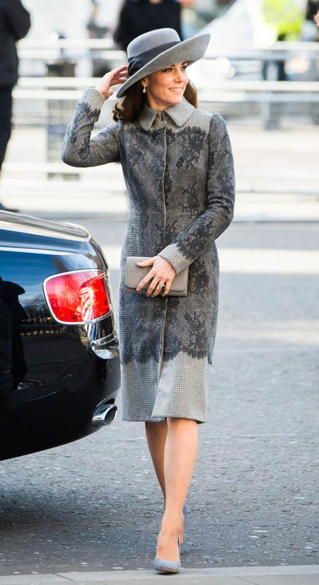 Wearing an Erdem coat and a John Boyd hat in March 2016.