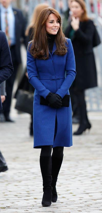 Wearing a Christopher Kane coat in October 2015.
