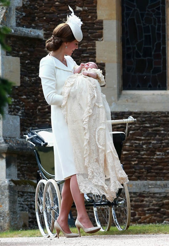 Wearing Alexander McQueen to the Christening of Princess Charlotte in July 2015.