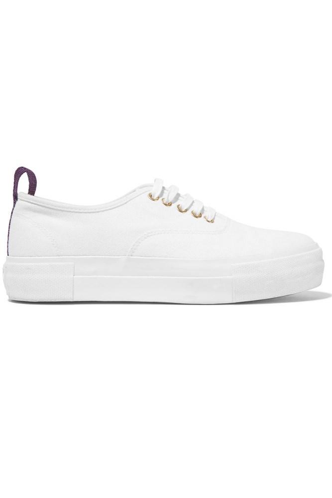 "<a href=""https://www.mychameleon.com.au/mother-white-canvas-sneaker-p-3141.html?typemf=women"">Sneakers, $210, Eytys at mychameleon.com.au</a>"